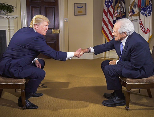 President Trump shaking the hand of CBN Founder Pat Robertson
