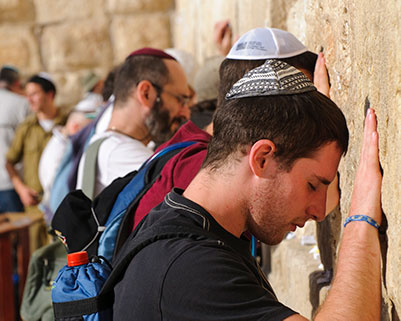 Men praying at the Western Wall in Jerusalem