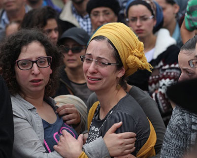 Two distraught ladies amongst the crowd afer a terror attack