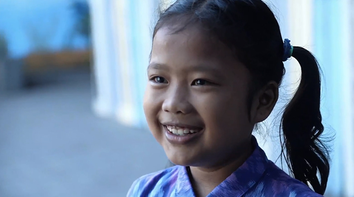 Nine-year-old orphan, Channa, smiles as she recounts the joy she feels knowing God as her Father.