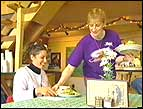 Irene Phillips serves 700 Club producer Zsa Zsa Palagyi at Hatcher Pass Lodge