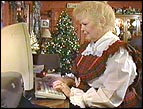 Marilyn Propst stays busy answering letters to Santa