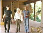 Randy, Liv, and Lisa Ryan outside the Travis home
