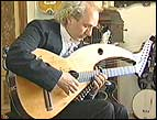 John Doan plays the harp guitar