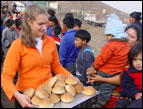 Sondra distributes bread in Peru