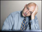daily Devotion picture of bald-headed male wearing a blue shirt and tie