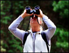 daily Devotion woman outdoors looking through binoculars