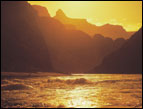 daily Devotion picture of golden sunset on the water with mountain peaks in the background