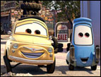 Luigi (voiced by Tony Shaloub) and Guido (voiced by Guido Quaroni) in 'Cars'
