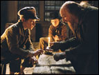 Barney Clark as Oliver and Ben Kingsley as Fagin in 'Oliver Twist'