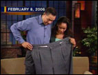 Pete Thomas demonstrates his former pants size to Kristi Watts