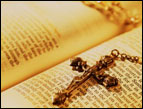 daily Devotion picture of open Bible with a necklace cross laying on top of the scriptures