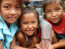 Three girls from Laos enjoy the fresh, clean water you provided.