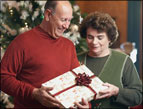daily Devotion picture of man and woman holding a wrapped present