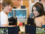 Zac Efron and Vanessa Hudgens on set