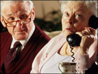 Before Cell Phones elderly couple using land-line telephone