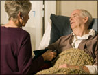 daily Devotion picture of elderly man in sickbed with woman sitting on the edge of the bed