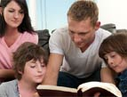 Christian family reading Bible