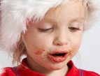 christmas toddler with chocolate mess on her face