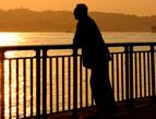 man relaxing at waterside