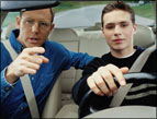 teen driving and father giving directions