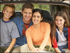 daily Devotion picture of family sitting in the opened rear of their vehicle