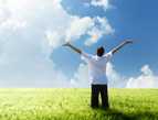 daily Devotion man praising god in sunshine on bright green grass