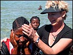 Heidi baptizes in the ocean