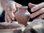 daily Devotion potter making a clay vessel