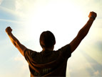 daily Devotion picture of man facing brightness with arms raised in praise