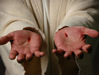 daily Devotion jesus with bleeding palms on his hands held open for you