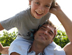 son on dad's shoulders