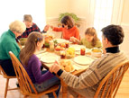 daily Devotion family praying holding hands at dinner table