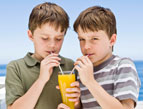 daily Devotion two boys sipping juice through straws sharing one glass