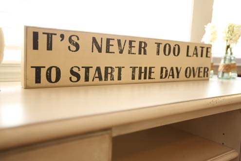 Sign says, It's never too late to start the day over