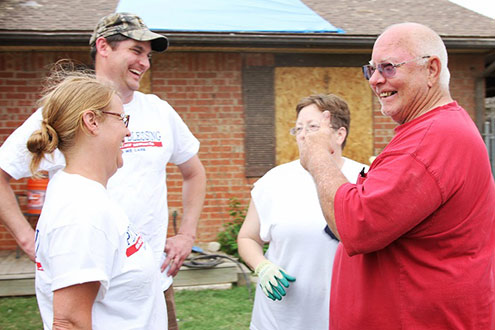 Steve and Wife laughing with Operation Blessing workers