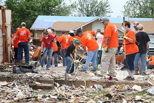 The Home Depot clean up volunteers clearing rubble.
