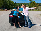 couple at crossroads arguing about directions