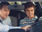 father son driving instruction tense situation