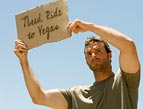 hitchhiker holding sign need ride to vegas