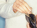 woman getting coins from change purse
