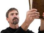 preacher holding up a Bible