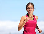 woman runner wearing pink compression shirt