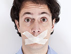 man with mouth taped shut