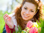 woman happy flowers tulips laying in grass