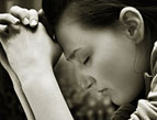 woman praying sincere prayer - black and white photo