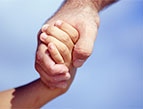 father holding hand of child