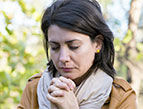 daily Devotion picture of young woman with brown hair praying
