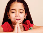 daily Devotion picture of little girl with brown hair praying with eyes closed