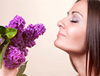 a woman smelling lavender flowers